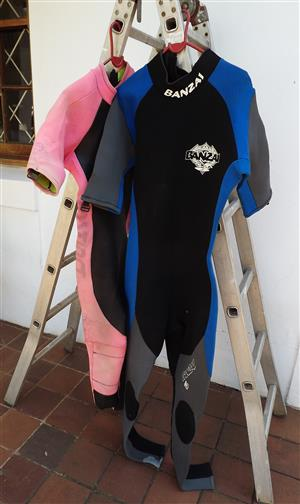 Man's and woman's wetsuits