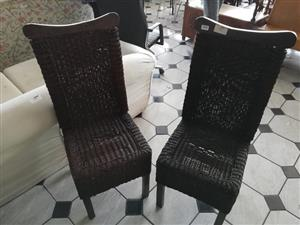 Two lovely wicker dining chairs