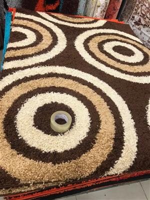 Beige, dark and light brown circular pattern carpet