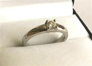 18 ct SOLID WHITE GOLD SOLITAIRE RING WITH .25 ct GENUINE DIAMOND