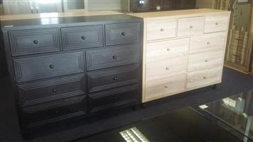 Dark and light wooden chest of drawers