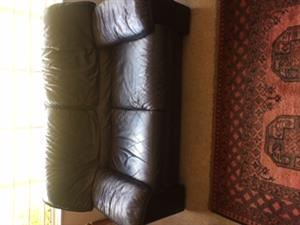 Three piece leather lounge suite