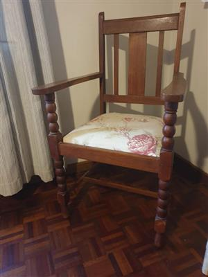Two solid wood chairs with turned legs