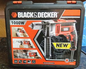 Brand new Black and Decker 1000W drill with carry case