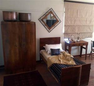2 Door wooden closet and single bed