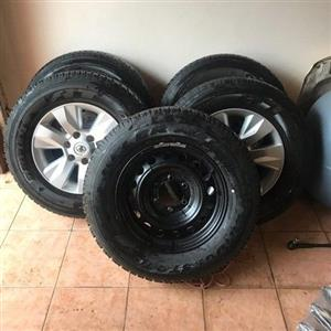 """17"""" Toyota mags with tyres."""