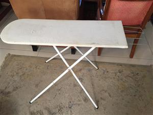 Ironing board with wood top and metal feet - height adjustable