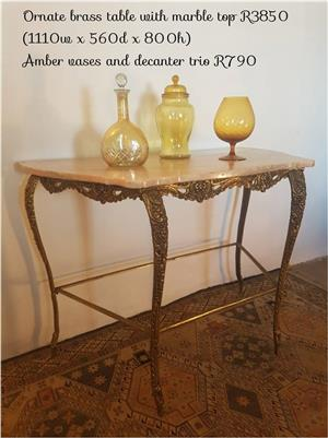 Ornate brass table with marble top and vases