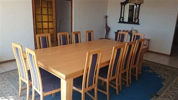 12 Seater solid oak table and chairs with cabinet