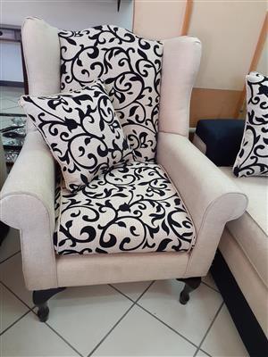 4 Piece beige & black lounge suite.