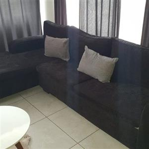 Corner lounge suite including cushions