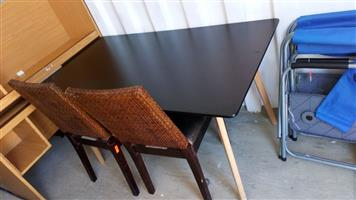 Dark wooden table and 2 chairs