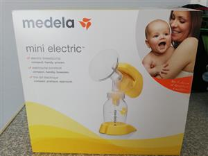 Medela Mini Electric Breast Pump & Pigeon Manuel Breast Pump