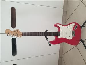 Red Squier Affinity Stratocaster guitar
