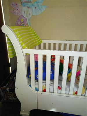 White sleigh cot in excellent condition with mattress and mattress protector