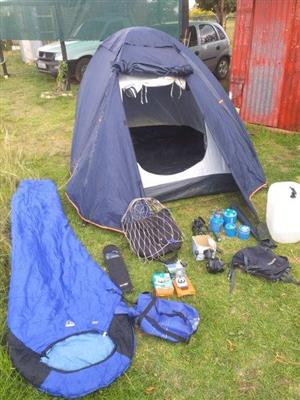 Various camping items, including tent, sleeping bag, gas stove and cooler bag