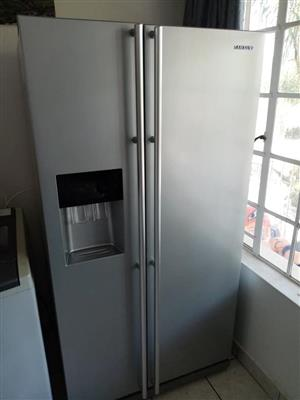 Metallic Silver Samsung side by side with water and ice Dispenser