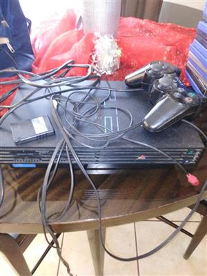 Playstation 2 with 25 games 1 remote and memory card