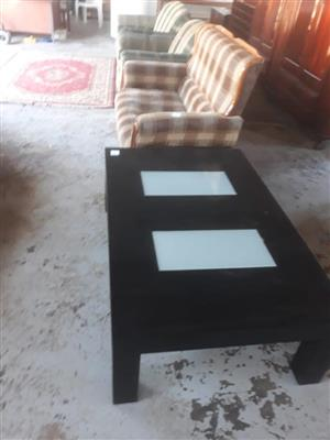 Black coffee table with lounge suite