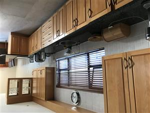 Solid wood and granite kitchen.