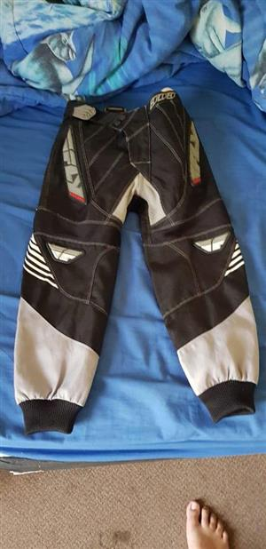 Black and grey biker pants