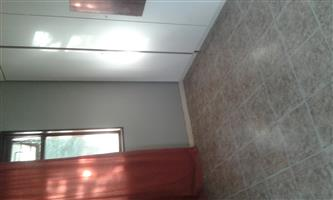Large single room in house..  beautifull large garden.  lots of trees. very central R3000 neg