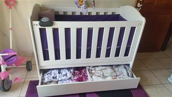 White wooden cot with drawer
