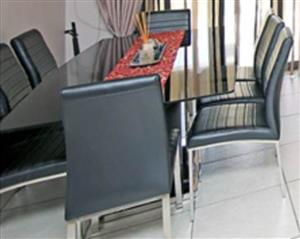 9 Piece Glass Table with 8 Leather chairs