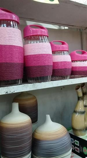 Pink material covered containers