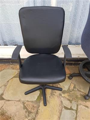 Black leather office chair with wheels