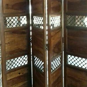 beautiful solid wood and iron room divider or headboard