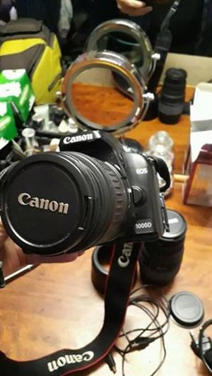 Canon 1000 d met stigma 30700 lens