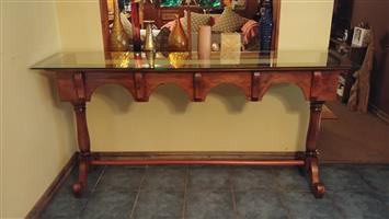 Beautiful long ornate wooden counter / server.