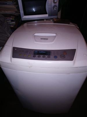 Lg fuzzy logic washing top loader machine