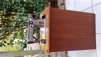 Vintage Singer 306K sewing machine in cabinet.