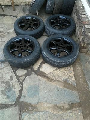 4/ 100 pcd 14 mags and tires