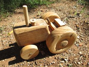 Antique, vintage hand-made wooden tractor, 50+ years old.