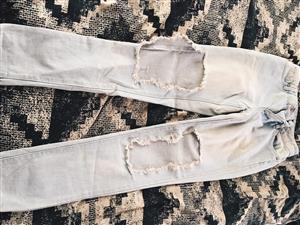 Light torn jeans for sale