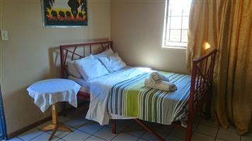 www.guesthousesmafikeng.co.za    Several to choose from in mafikeng / Mmabatho. From R200 per night to R650 per night.