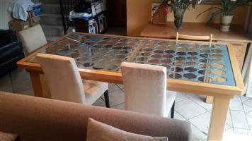Wood and glass oblong dining room table.  Will seat 10 persons.