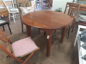 Small, round, teak dining or hall table
