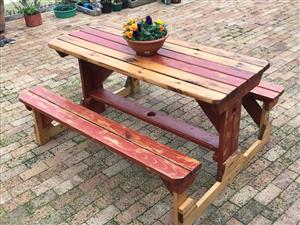 8 Seater outdoor picnic table. Unique terracotta rustic finish. R2200.00 negotiable.