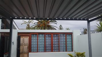 ROOFING INSTALLATIONS CARPORT BUILDING