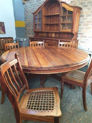 Heavy Solid Wood Dining Room Set for sale.