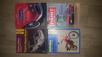 Selection of old car and bike manuals