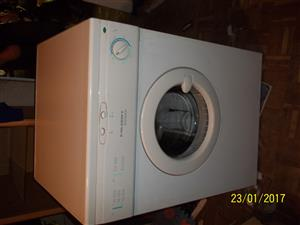 a white tumble drier for sale.