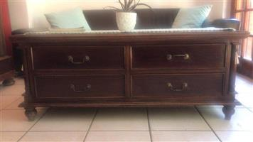 COFFEE TABLE. WETHERLYS SOLID WOOD 4 DRAWERS EACH SIDE. L 12500 x W 650 top quality Teak coffee table.