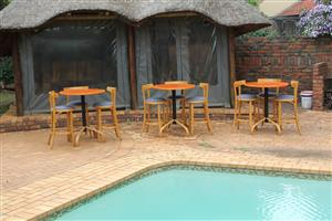 Three round bar tables and nine upholstered bar chairs for sale