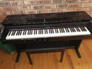 Clavitech upright electric piano