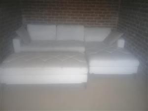 White L shaped couch with large foot rest
